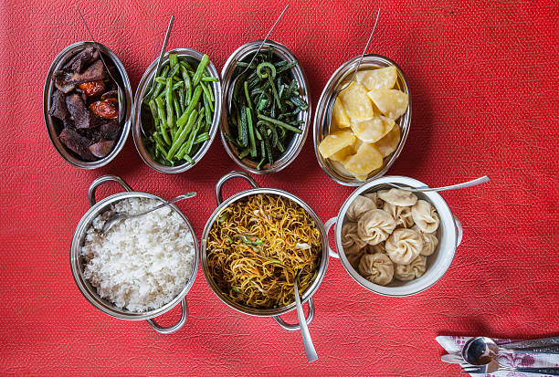 Bowls of typical Bhutanese dishes and vegetables